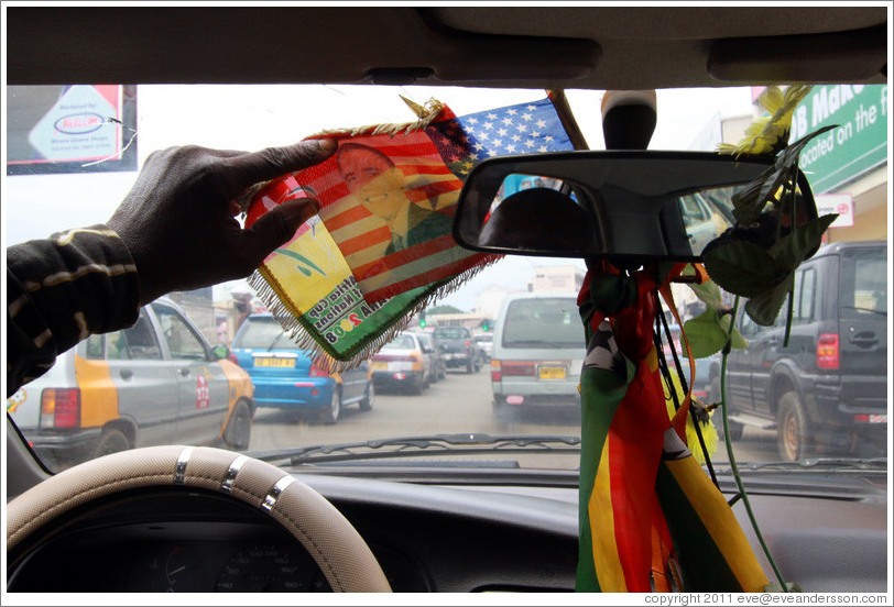 Barack Obama on an American flag, hanging from a taxi driver's rear view mirror.