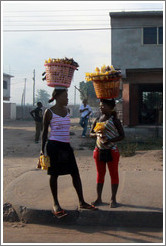 Women with baskets on their heads.