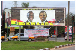 Billboard reading Partnership for Change / Akwaaba, with photos of the president of Ghana, John Atta Mills, and the president of the United States, Barack Obama.