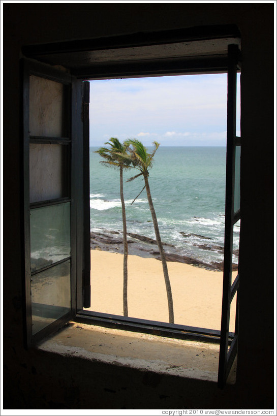 View of the coast through a window in Elmina Castle.