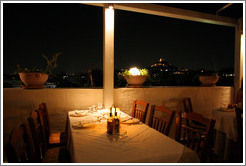 Ελαια restaurant.  Rooftop dining area at night.