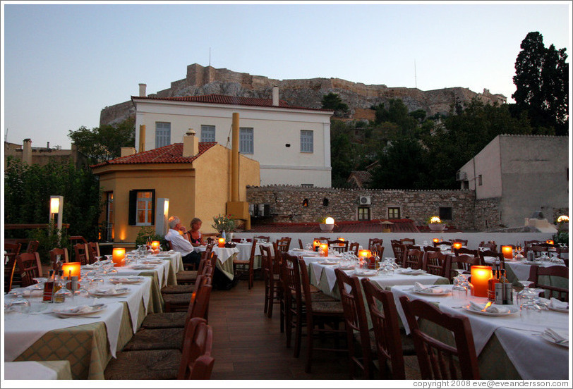 Ελαια restaurant.  Rooftop dining area with the Acropolis (Ακρόπολη) behind it.