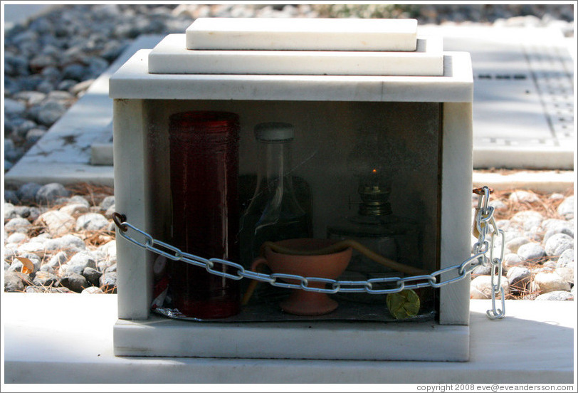 "A ""locker"" containing things to be used when visiting a grave, including a candle and cleaning supplies.  The First Cemetery of Athens (Πρώτο Νεκροταφείο Αθηνών)."