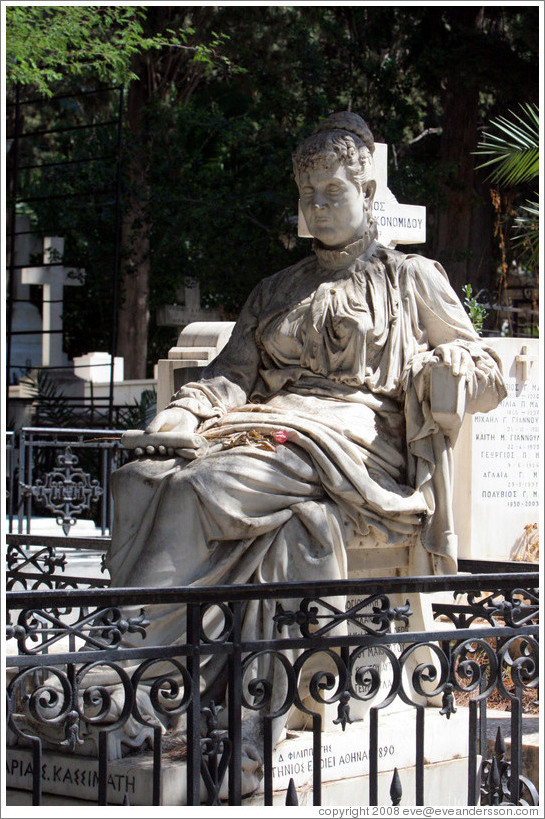 Figure of woman on chair.  The First Cemetery of Athens (Πρώτο Νεκροταφείο Αθηνών).