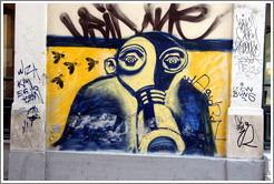 Graffiti depicting a man wearing a gas mask.