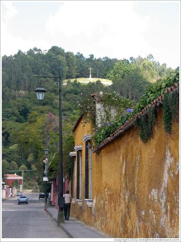 Antigua, Guatemala.  Steet; Cerro de la Cruz in the background.