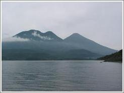 Lake Atitlan with Volcanoes Toliman and Atitlan behind.