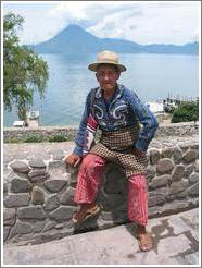 Man in traditional wear in Panajachel, in front of Lago de Atitlán.