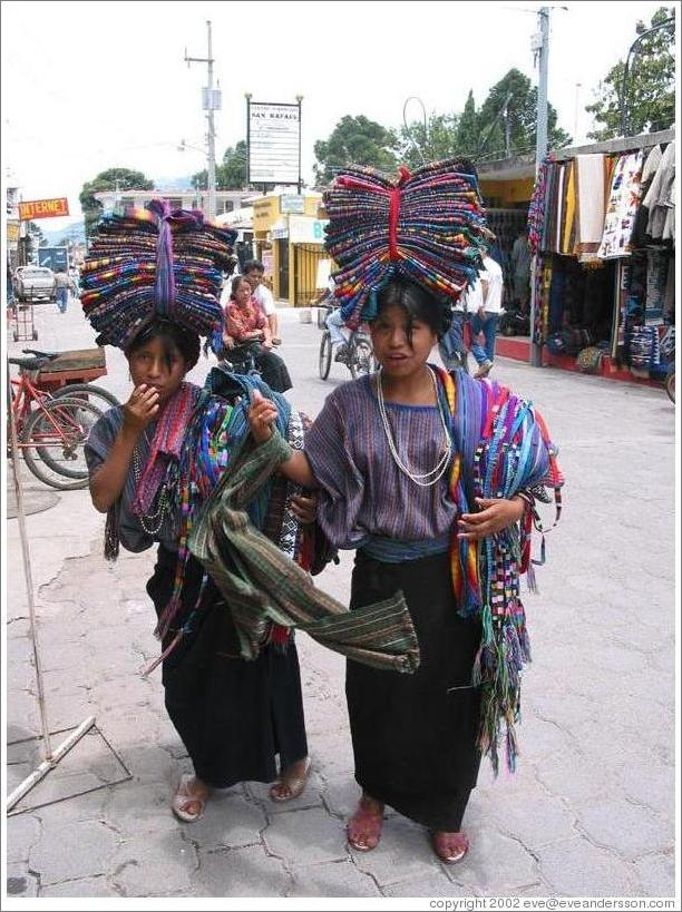 Girls balancing cloths on their heads, Panajachel.