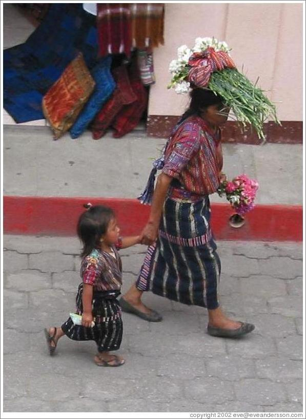 Woman with flowers on her head and girl, Panajachel.