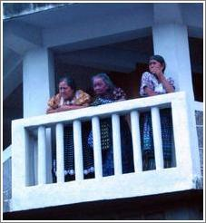 Three women on balcony, San Pedro.