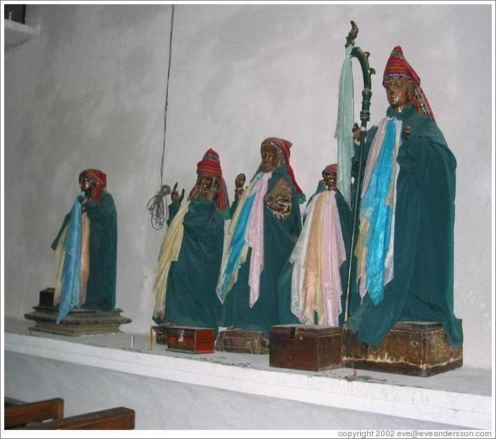 Christian figures wearing Mayan clothes in a Catholic church in Santiago.