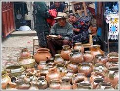 Woman and man selling pots.
