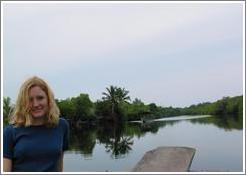Eve on boat in the mangrove swamp.