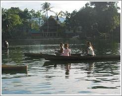 Three girls in boat.