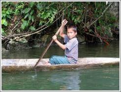Boy in canoe.
