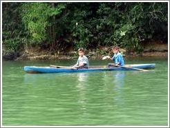 Boys in canoe.