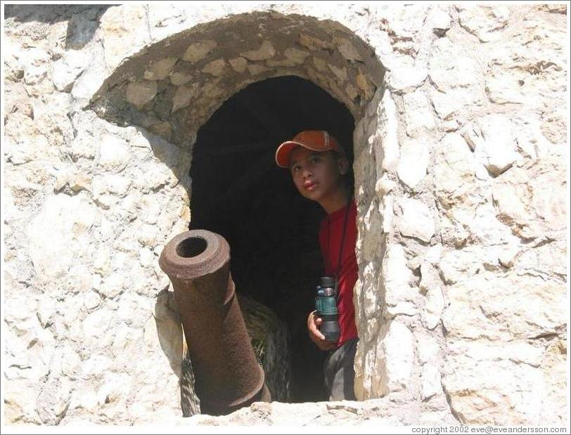 Castillo de San Felipe.  Boy and cannon.
