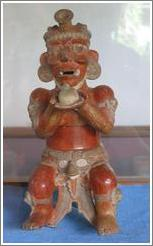 Tikal.  Figure holding offering, Ceramics Museum.