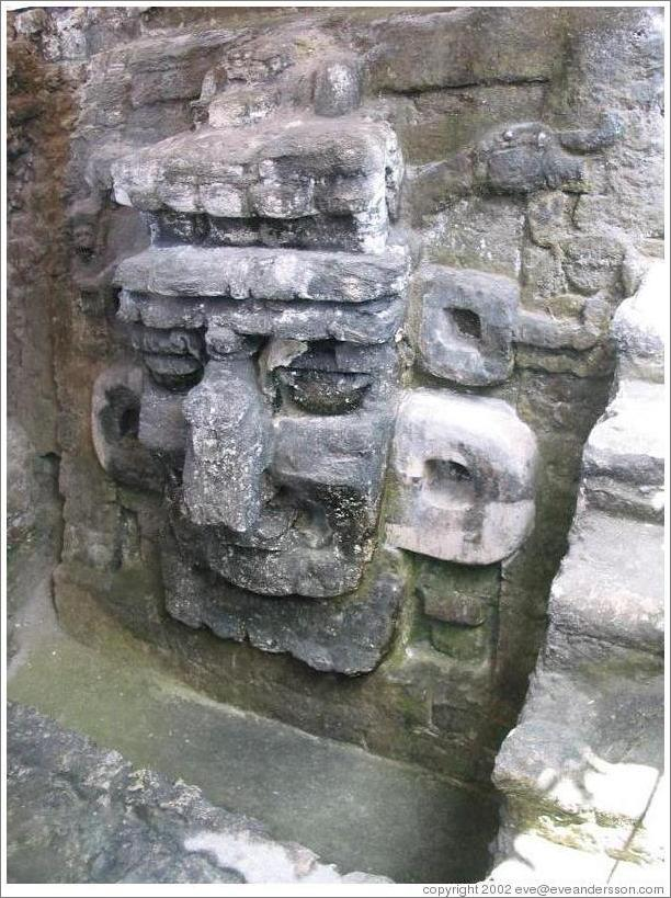 Tikal.  Carved face, North Acropolis.