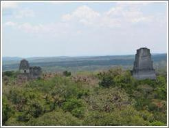 Tikal.  Templos I, II, and III, as viewed from Templo IV.