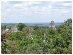 Tikal.  Templos I and II, as viewed from the big pyramid at Mundo Perdido.