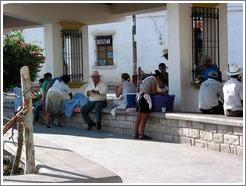 Parque Central.  Women washing, men sitting.