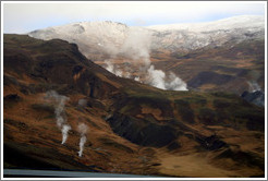 Geothermal steam rising from the ground.