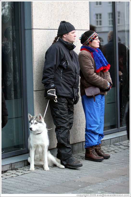 Couple and husky.