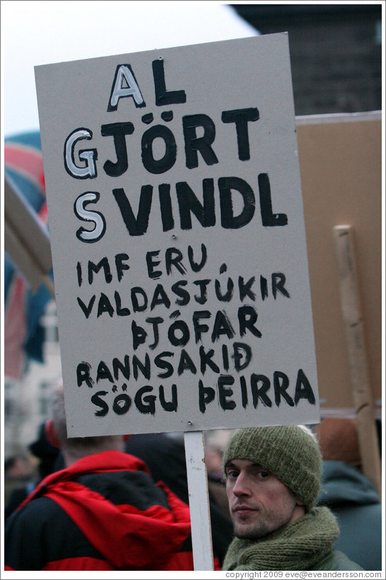"Protest in Reykjavik.  The sign says ""Al gj?rt svindl IMF eru valdasj?kir ?j? rannsaki?gu ?eirra"" (""Complete swindle; the IMF are power-greedy thieves, read up on their history"")."