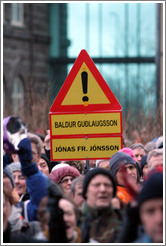 Reykjavik protest.  The sign depicts a yield symbol with the names Baldur Gu?gsson (Permanent Secretary of the Ministry of Finance) and J? Fr. J?on (Director General of the Financial Supervisory Authority, who was fired).