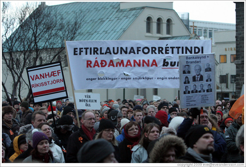 "Reykjavik protest.  The wide sign says ""Eftirlaunaforr?indi r?manna burt; engar blekkingar; engar smj?rkl?r; engin undanbr?g?""Away with pension privileges of officials; no deceptions; no pinches of butter [diversionary tactics]; no tricks."")  The sign on the left says ""Vanh?r?sstj? (""Unfit  Government""). The sign on the right says ""Bankaleynd = Brandari; ?tta er stj?Kaup?ings sem strika?fir; skuldir upp ?3 milljar?r? (""ank Secrecy = A joke; This is the board of Kaupthing which erased debts amounting to 53 billion kronur"")."
