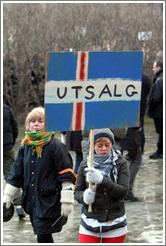 "Reykjavik protest.  The sign depicts an Icelandic flag with ""UTSALG"" (the Norwegian word for ""SALE"") on it, implying Iceland is for sale."