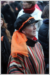 Reykjavik protest.  Woman with orange scarf symbolizing peaceful protest.