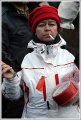 Reykjavik protest.  Smoking woman banging a pot.