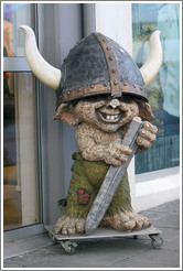 Viking troll outside storefront.