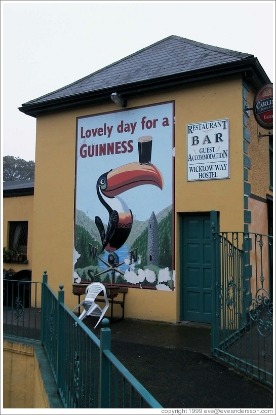 """Lovely day for a Guinness"" -- on the side of a pub in a tiny town south of Dublin"