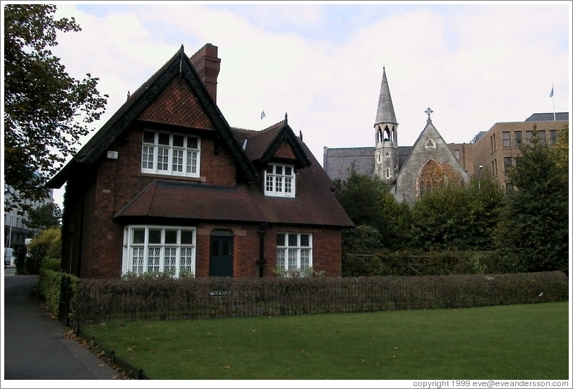A cottage in Stephen's Green. Behind it is an old, beautiful church.