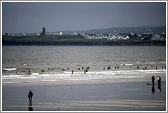 Lahinch Beach, with surfers from a surfing school.