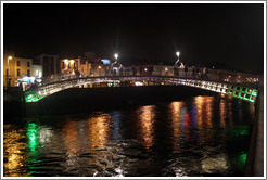 The Ha'penny Bridge over the River Liffey at night.
