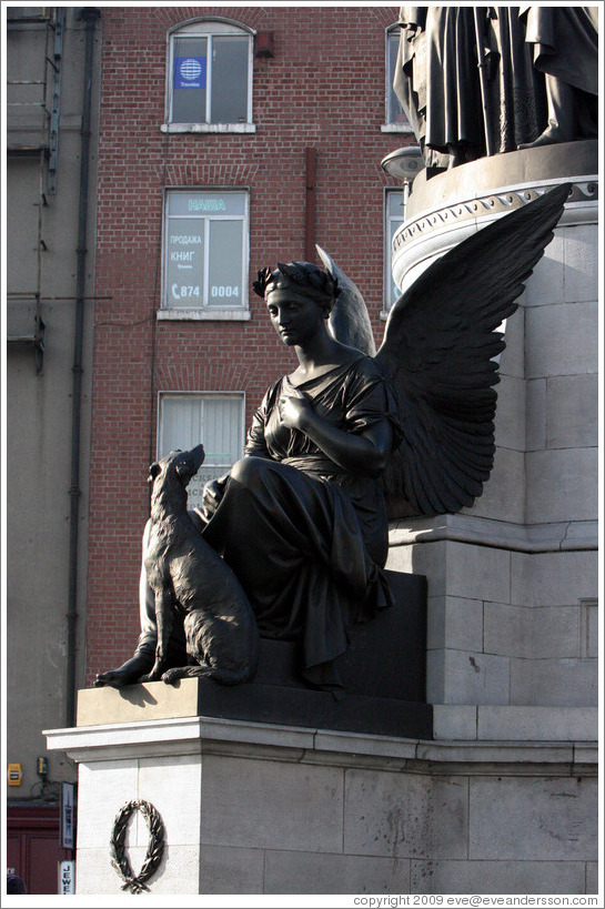 Statue of angel and dog.  O'Connell Street.