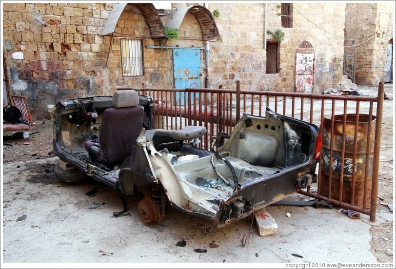 Destroyed vehicle in a courtyard, old town Akko.
