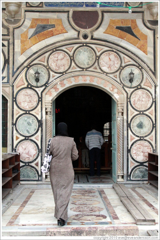 Woman entering Al-Jazzar Mosque.  Old town Akko.