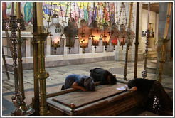 Stone of Unction, believed to be the place where Jesus' body was washed after his death.  Church of the Holy Sepulchre, Christian Quarter, Old City of Jerusalem.