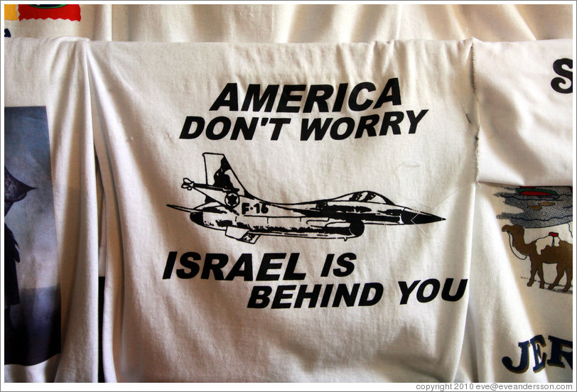 "Shirt for sale in the souk; it reads, ""America don't worry / Israel is behind you."""