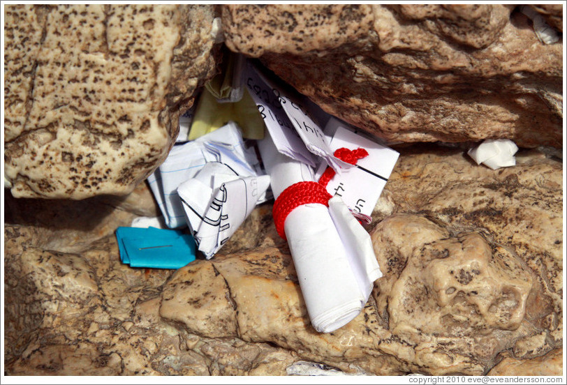 Papers stuffed into a crack in the Western (Wailing) Wall, Old City of Jerusalem.