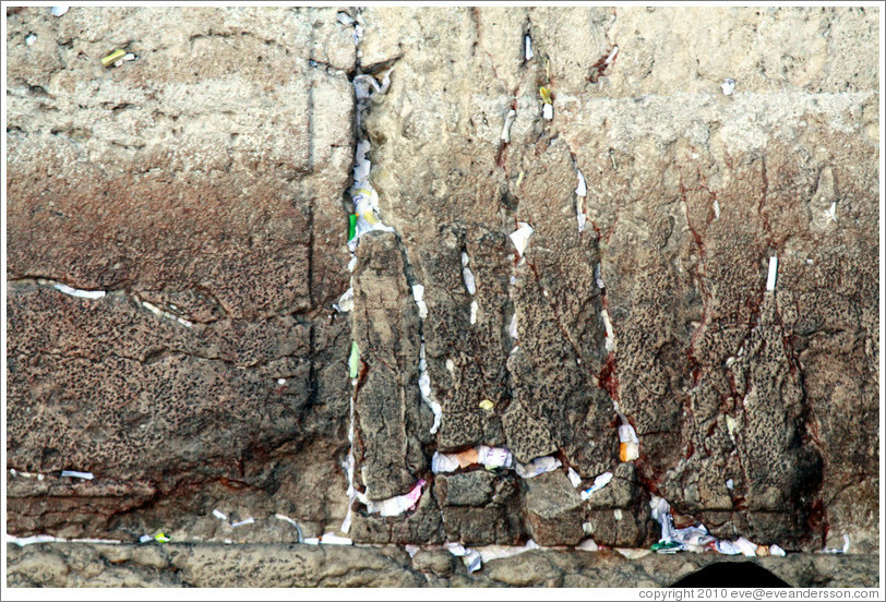 Papers stuffed into cracks in the Western (Wailing) Wall, Old City of Jerusalem.