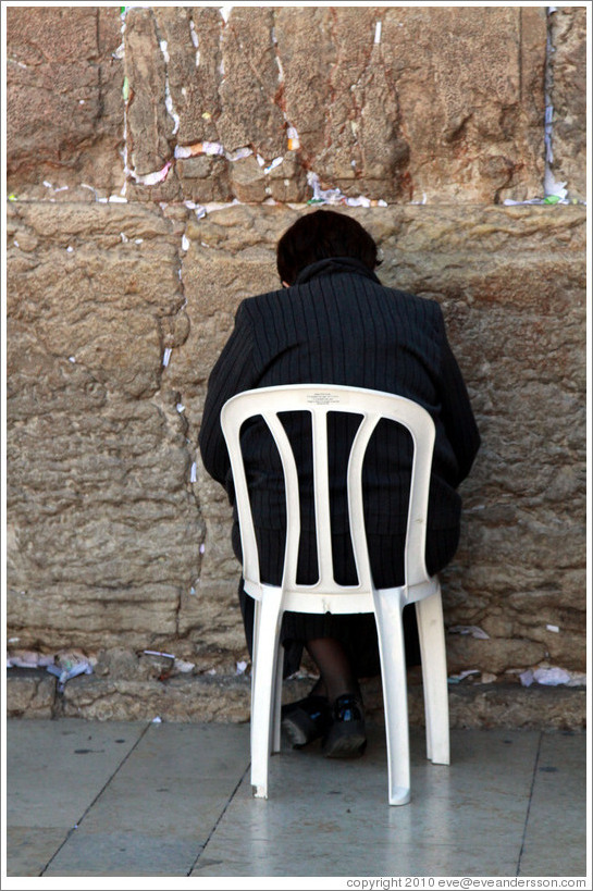 Woman praying at the Western (Wailing) Wall, Old City of Jerusalem.
