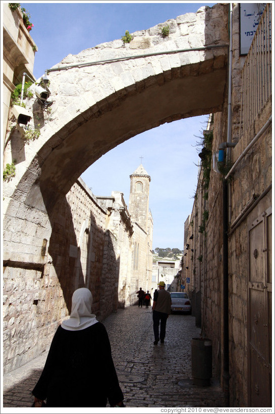 Woman and arch, Via Dolorosa, Muslim Quarter, Old City of Jerusalem.