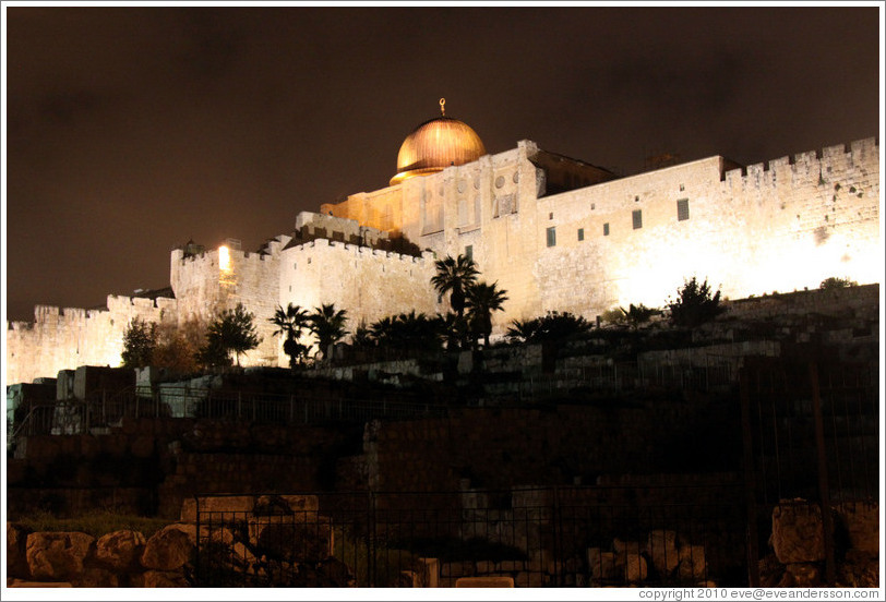 Night view of a dome and walls of the Old City of Jerusalem.